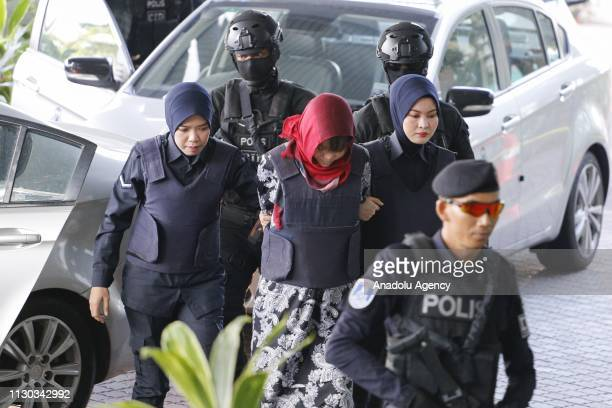 Vietnamese Doan Thi Huong escorted by Malaysian police officers arrives at the Shah Alam High Court to stand trial for her alleged role in the...