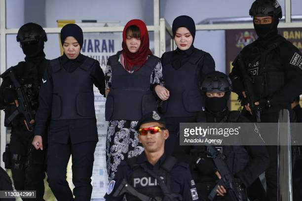 Vietnamese Doan Thi Huong escorted by Malaysian police officers leaves the Shah Alam High Court after attending trial for her alleged role in the...