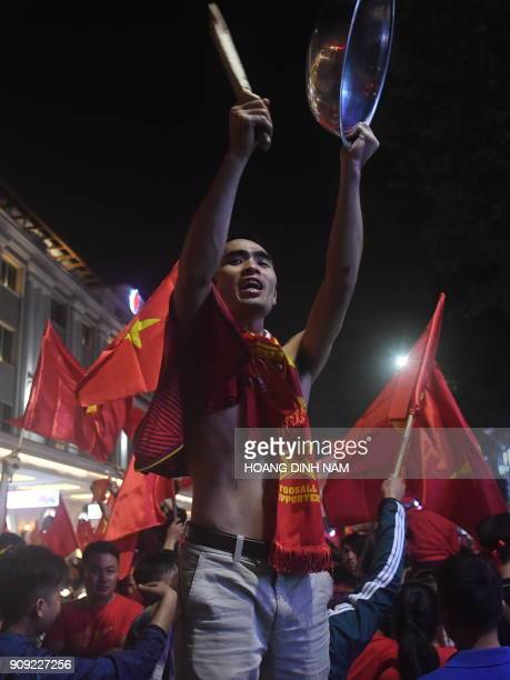 Vietnamese fans celebrate after the country's U23 team defeated Qatar at the semifinal of the U23 AFC Championship in Hanoi on January 23 2018 / AFP...