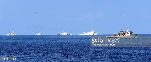 Vietnamese fisheries surveillance force vessel is chased by Chinese Maritime Police Bureau ships near the disputed Paracel Islands near the disputed...