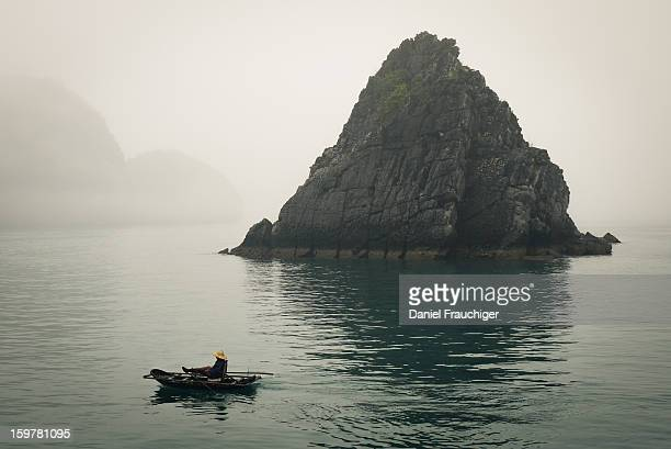 CONTENT] Vietnamese fisherman rowing in the Halong Bay Vietnam March 6 2011