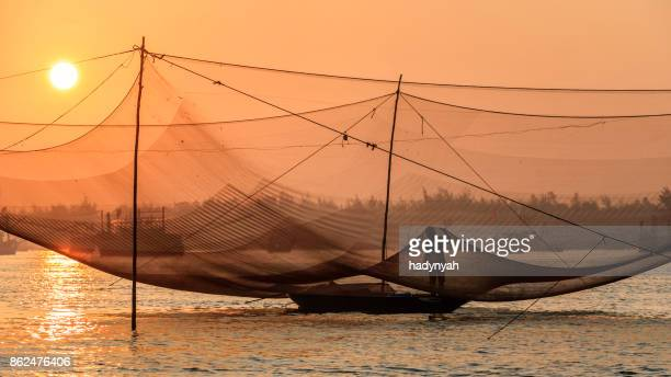 vietnamese fishing nets on thu bon river near hoi an in central vietnam - can tho province stock pictures, royalty-free photos & images