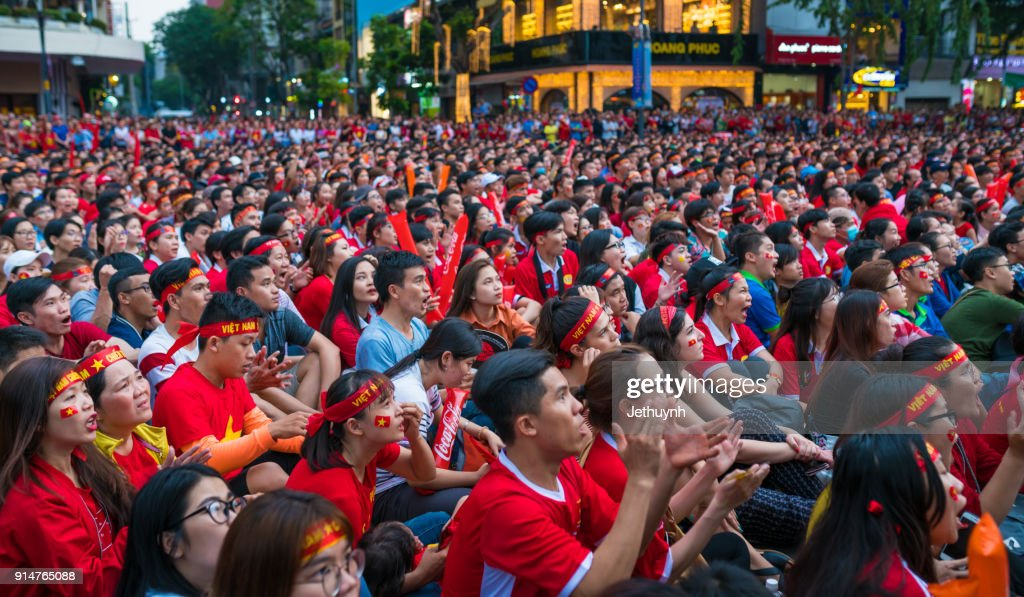 Vietnamese Football Fans Rally In Nguyen Hue Street To Watch