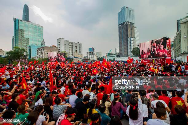 Vietnamese football fans watch a television broadcast in Ho Chi Minh city on January 27 2018 showing the 2018 AFC U23 Championship final football...