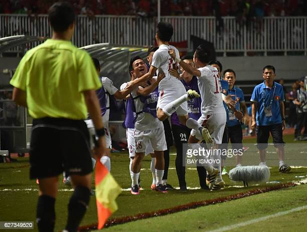 Vietnamese football player celebrate their goal against Indonesia during the semi-final AFF Suzuki Cup 2016 in Cibinong, West Java, on December 3,...
