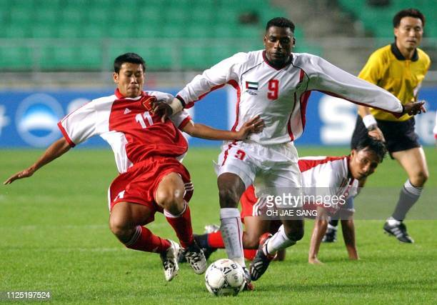 Vietnamese football player Thach Bao Khanh and United Arab Emirates' Salem AlAbadla vie for the ball 27 September 2002 during the first round of the...