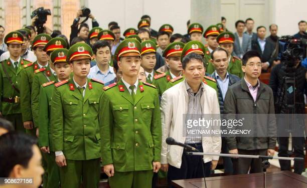 Vietnamese former state oil executive Trinh Xuan Thanh and others defendant listens to the verdict in his trial at Hanoi's People's Court on January...