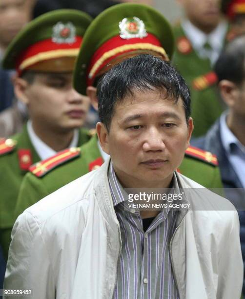 Vietnamese former state oil executive Trinh Xuan Thanh listens to the verdict in his trial at Hanoi's People's Court on January 22 2018 Thanh who was...