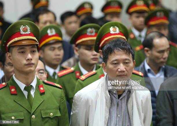 TOPSHOT Vietnamese former state oil executive Trinh Xuan Thanh listens to the verdict in his trial at Hanoi's People's Court on January 22 2018 Thanh...