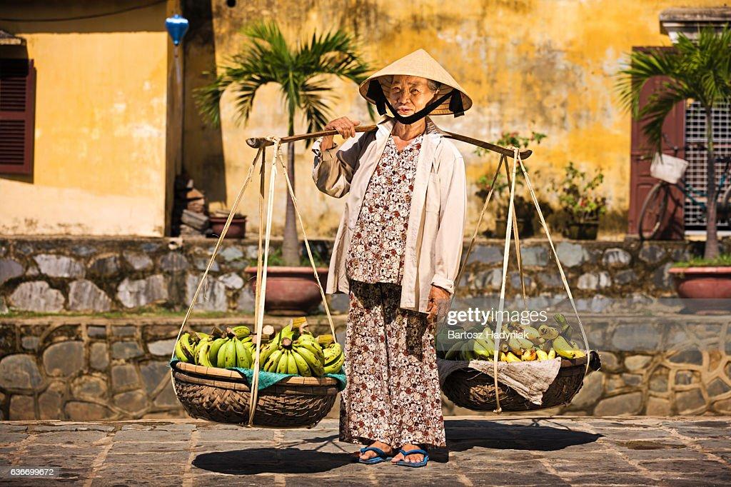 Vietnamese fruit seller : Stock Photo