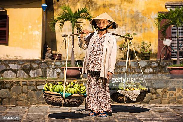 vietnamese fruit seller - traditionally vietnamese stock pictures, royalty-free photos & images