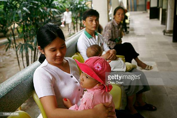 Vietnamese girl Dinh Thi Hao diagnosed with ovarian carcinoma and her mother Vu Thi Luong at the National Cancer Hospital in Hanoi Statistics from K...