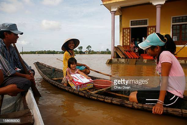 Vietnamese girl Nguyen Ngoc Kim Anh gets a box of instant noodles given to her by the local authority in Trung Don village Hai Thanh commune Hai Lang...