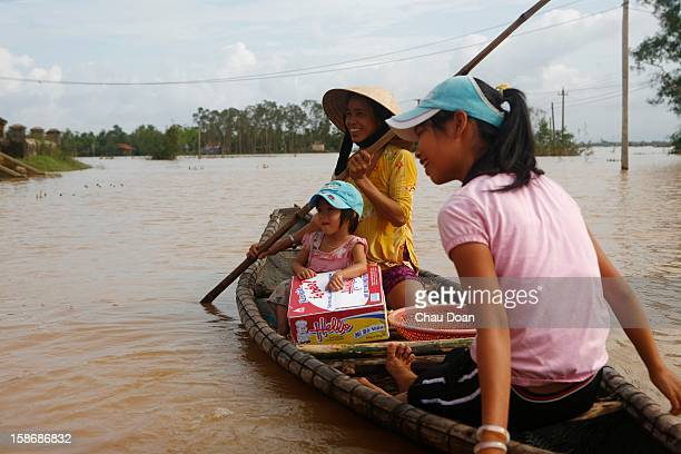 Vietnamese girl Nguyen Ngoc Kim Anh with a box of instant noodles given to her by the local authority in Trung Don village Hai Thanh commune Hai Lang...