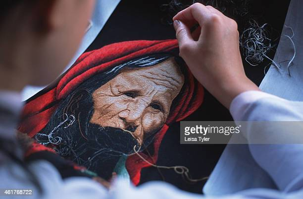 Vietnamese girl practicing the traditional art of embroidery at the Cultural Village in Dalat a series of workshops set up to illustrate Vietnam's...
