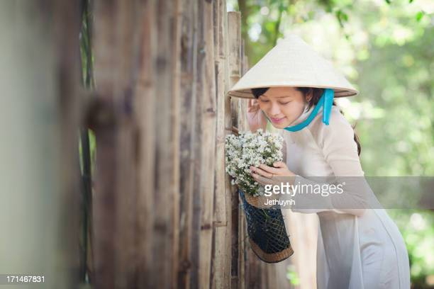 Vietnamese Girl with Ao Dai and Leaf Hat