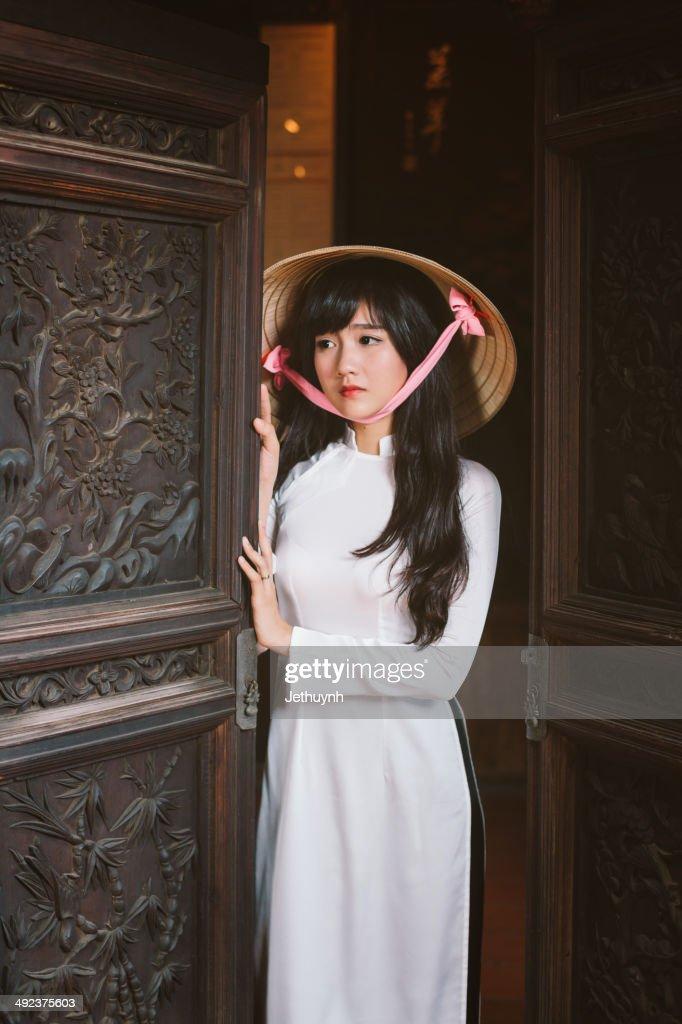 Vietnamese Girl with ao dai and non la. : Stock Photo