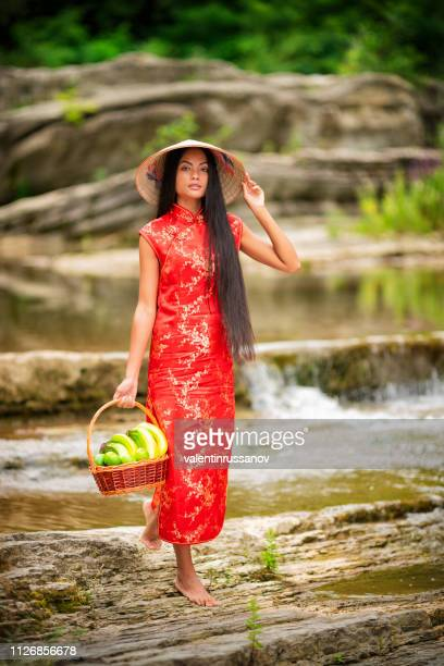 Vietnamese girls with Ao Dai, famous traditional custume for woman in VIetnam on the river