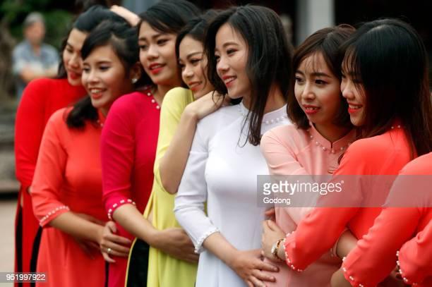 Vietnamese graduates wearing tradional dress Ao Dai at Temple of Literature Hanoi Vietnam