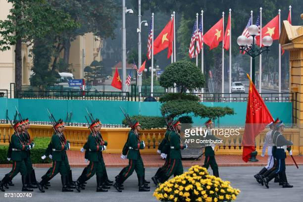 Vietnamese honour guard march before a welcoming ceremony for US President Donald Trump at the Presidential Palace in Hanoi in Hanoi on November 12...