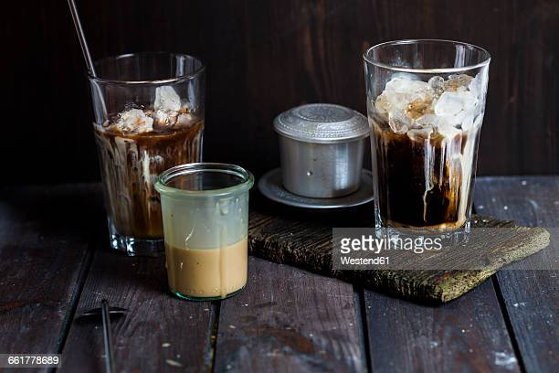 vietnamese iced coffee with strong coffee, sweetened condensed milk, ice - traditionally vietnamese stock pictures, royalty-free photos & images