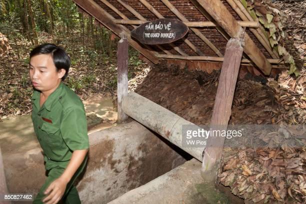 Vietnamese man exiting a Cu Chi tunnel at Ben Dinh Cu Chi near Ho Chi Minh City Vietnam