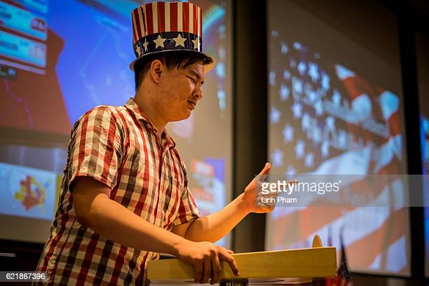 Vietnamese man tries the dummy president podium at the live election results watch party hosted by the United States Consulate General at a...