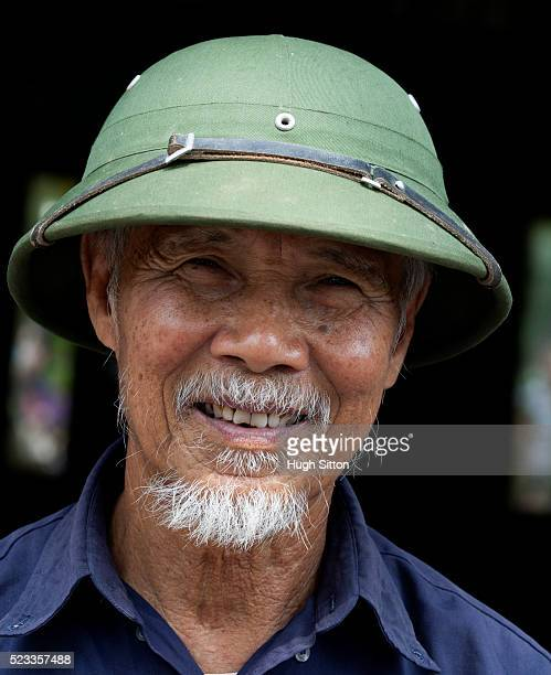 vietnamese man wearing traditional hat. vietnam - hugh sitton stock pictures, royalty-free photos & images