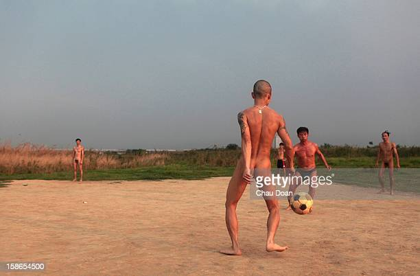 Vietnamese men play soccer on an island in the middle of the Red River near Hanoi The seasonal island has become a naturist's area where men come to...