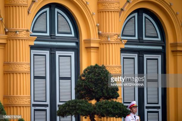Vietnamese military personnel wait for the arrival of Cambodia's Prime Minister Hun Sen for a welcoming ceremony at the Presidential Palace in Hanoi...