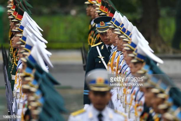 TOPSHOT Vietnamese military personnel wait for the arrival of Cambodia's Prime Minister Hun Sen for a welcoming ceremony at the Presidential Palace...