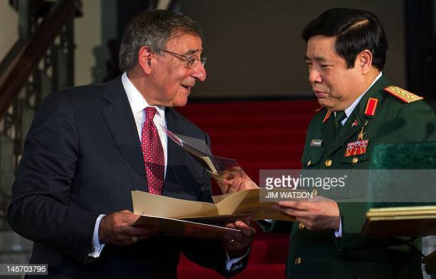 Vietnamese Minister of Defense Phuong Quang Thanh receives the Vu Dinh Doan diary which was taken by US Marine Robert Frazure following Operation...