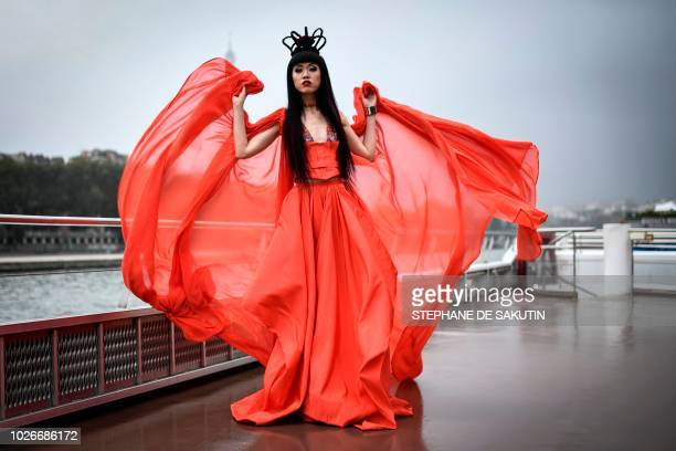 Vietnamese model Jessica Minh Anh poses with one of her creatian before her 2018 fallwinter fashion show staged on a floating catwalk aboard a...