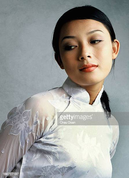 Vietnamese model wearing the traditional Vietnamese costume called 'Ao Dai'
