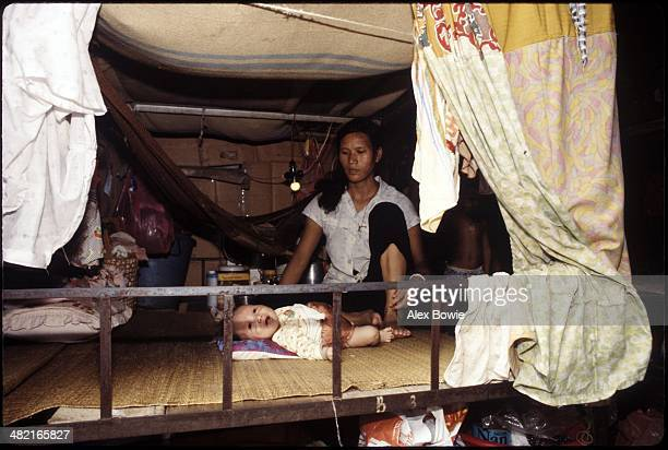 Vietnamese mother and daughter await resettlement to a third country at the Kai Tak East camp a holding centre for refugees Hong Kong China 22 May...