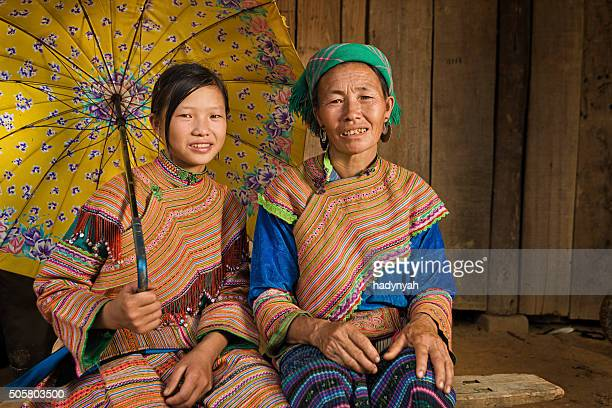 vietnamese mother from flower hmong tribe with her daughter - vietnamese ethnicity stock pictures, royalty-free photos & images