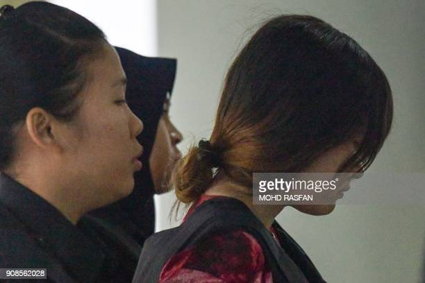 Vietnamese national Doan Thi Huong is escorted by Malaysia police during a court appearance with Indonesian national Siti Aisyah at the Shah Alam...