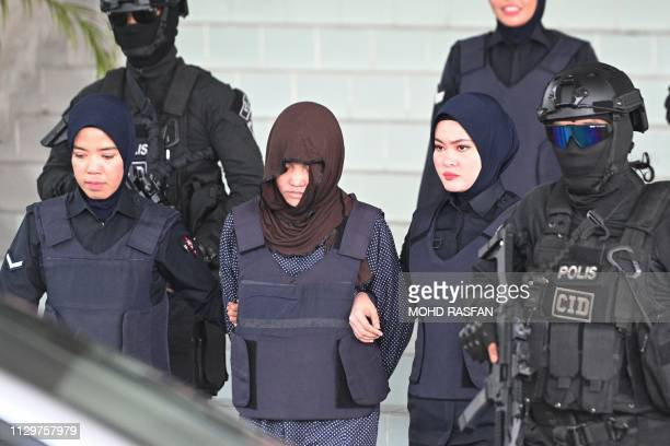 TOPSHOT Vietnamese national Doan Thi Huong is escorted by Malaysian police after a hearing at the Shah Alam High Court outside Kuala Lumpur on March...