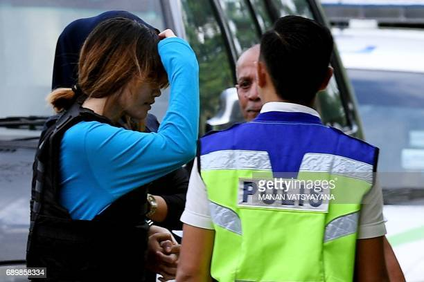 Vietnamese national Doan Thi Huong is escorted by Malaysian police for a court appearance with Indonesian national Siti Aisyah at the Sepang...