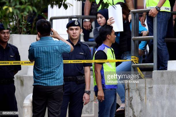 Vietnamese national Doan Thi Huong is escorted by Malaysian police after a court appearance with Indonesian national Siti Aisyah at the Sepang...