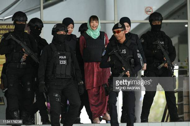 Vietnamese national Doan Thi Huong is escorted by Malaysian police out of the High Court in Shah Alam on April 1 2019 A Vietnamese woman accused of...