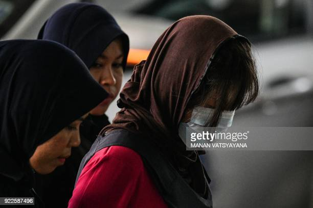 Vietnamese national Doan Thi Huong is escorted by Malaysian police for another appearance at court for her trial at the Shah Alam High Court in Shah...
