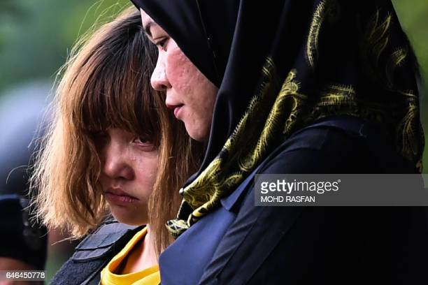 Vietnamese national Doan Thi Huong is escorted with a heavy police presence after a court appearance with Indonesian national Siti Aisyah at the...