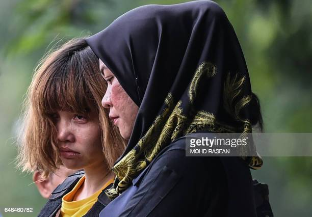 TOPSHOT Vietnamese national Doan Thi Huong is escorted with a heavy police presence after a court appearance with Indonesian national Siti Aisyah at...