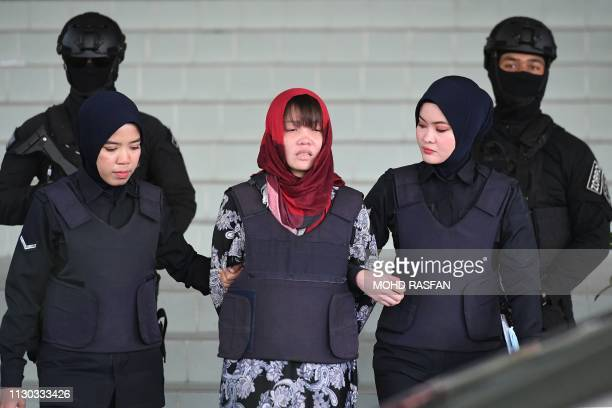 Vietnamese national Doan Thi Huong leaves Shah Alam High Court escorted by Malaysian police outside Kuala Lumpur on March 14 2019 A Vietnamese woman...