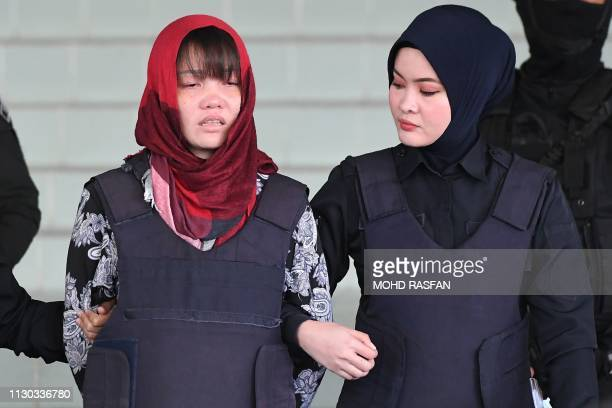 TOPSHOT Vietnamese national Doan Thi Huong leaves Shah Alam High Court escorted by Malaysian police outside Kuala Lumpur on March 14 2019 A...