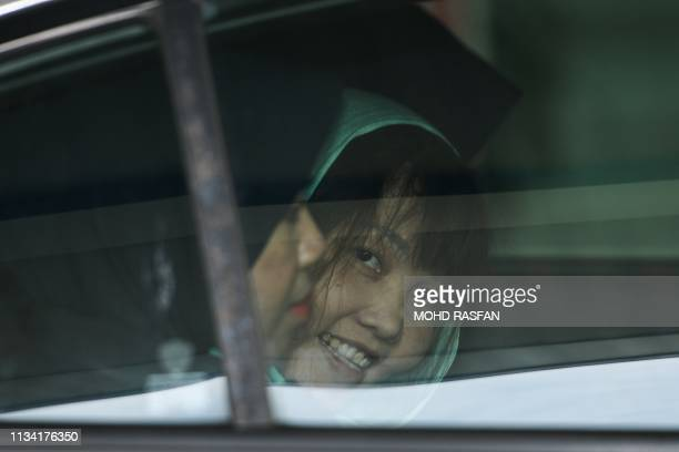 Vietnamese national Doan Thi Huong smiles from a car as she is escorted by Malaysian police out of the High Court in Shah Alam on April 1 2019 A...