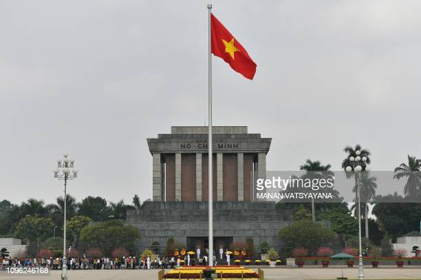 A Vietnamese national flag flutters in the wind at the Ho Chih Minh mausoleum in Hanoi on February 9 2019 US President Donald Trump announced on...