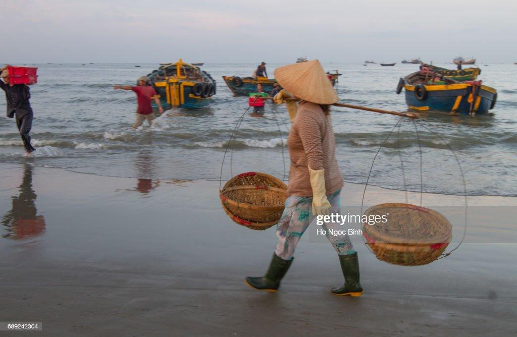 LONG HAI, VIETNAM - MAY 18, 2017: Vietnamese Non La at fishing village Long Hai, Vietnam : Stock Photo