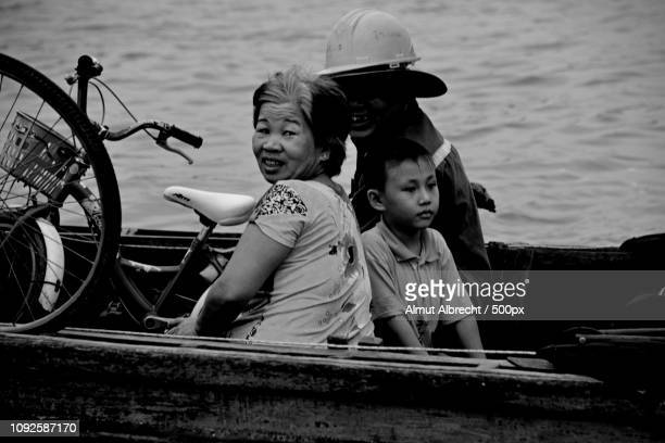 vietnamese people in a boat on the mekong river